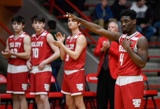 Tell City's Ty Smith (4) is introduced as the Mater Dei Wildcats play the Tell City Marksmen in the Class 2A Sectional Championship at Huntingburg's Memorial Gym Saturday, March 2, 2019.