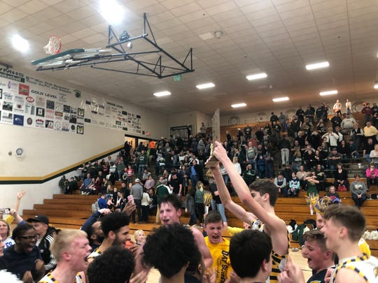 Day School celebrates after defeating Wood Memorial 39-37.