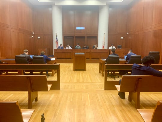 Amplify counsel (left) and Unite counsel (right) appear in front of the Elections Commission at the FSU College of Law.