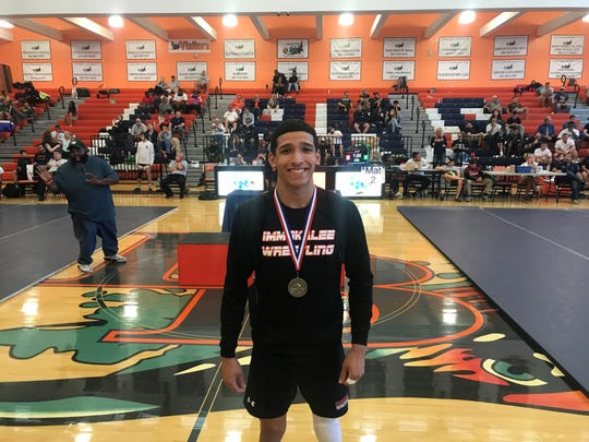 Immokalee's Gabriel Ramirez smiles as he is crowned the regional champion for a second consecutive year in the 126-pound weight class at the Class 1A-Region 3 wrestling tournament Saturday.