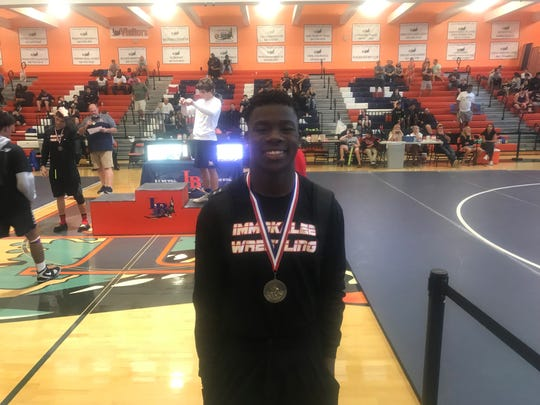 Immokalee's Neverthesonne Latens is crowned the regional champion for the 145-pound weight class at the Class 1A-Region 3 wrestling tournament Saturday. This is his first regional championship.