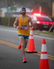 Jason Ayr won the Lazy Flamingo Half Marathon in the fog on Sunday, March 3, 2019, in Fort Myers.