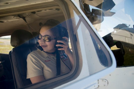 Pepper Rhodes, a local eight grader from Paul Laurence Dunbar Middle School, prepares to fly on Sunday March 3, 2019, at Page Field in Fort Myers. Pepper is a member of the EAA Chapter 66 along with her parents Candy and Matt and has been learning to fly airplanes since she was 10 years old.