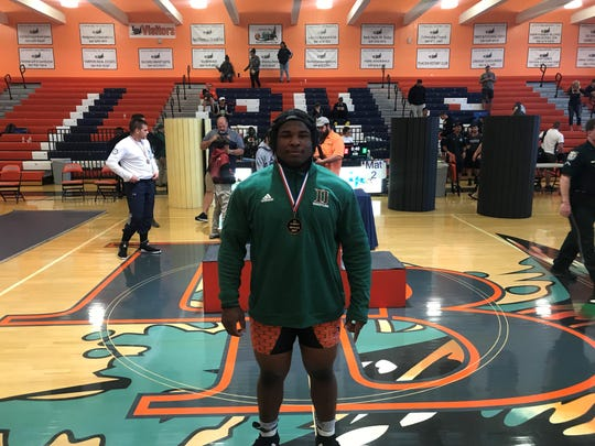 Dunbar's Jacquez Shird smiles after he defeated t Javier Arango via a competitive 5-2 decision finish third at 285 pounds at the Class 1A-Region 3 wrestling tournament Saturday.