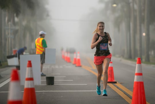Diana Sitar finished as the second-place woman in the Lazy Flamingo Half Marathon in the fog on Sunday, March 3, 2019, in Fort Myers.