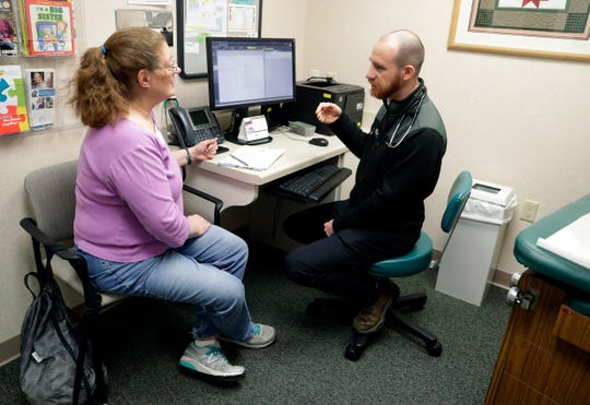 Dr. Matt Wheeler meets with a patient on Feb. 21 at Mosaic Family Health Clinic in Appleton. Wheeler was part of the first group of graduates from the Medical College of Wisconsin-Green Bay.