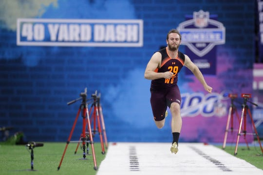 Clemson wide receiver Hunter Renfrow runs the 40-yard dash during the NFL football scouting combine, Saturday, March 2, 2019, in Indianapolis. (AP Photo/Darron Cummings)