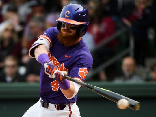 Clemson senior Grayson Byrd (4) attempts to hit the ball during their game against South Carolina at Fluor Field Saturday, March 2, 2019.