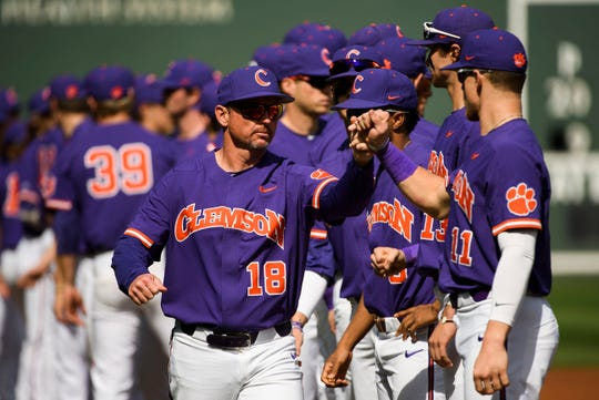 Clemson head coach Monte Lee (18) with his team during their game against South Carolina at Fluor Field Saturday, March 2, 2019.