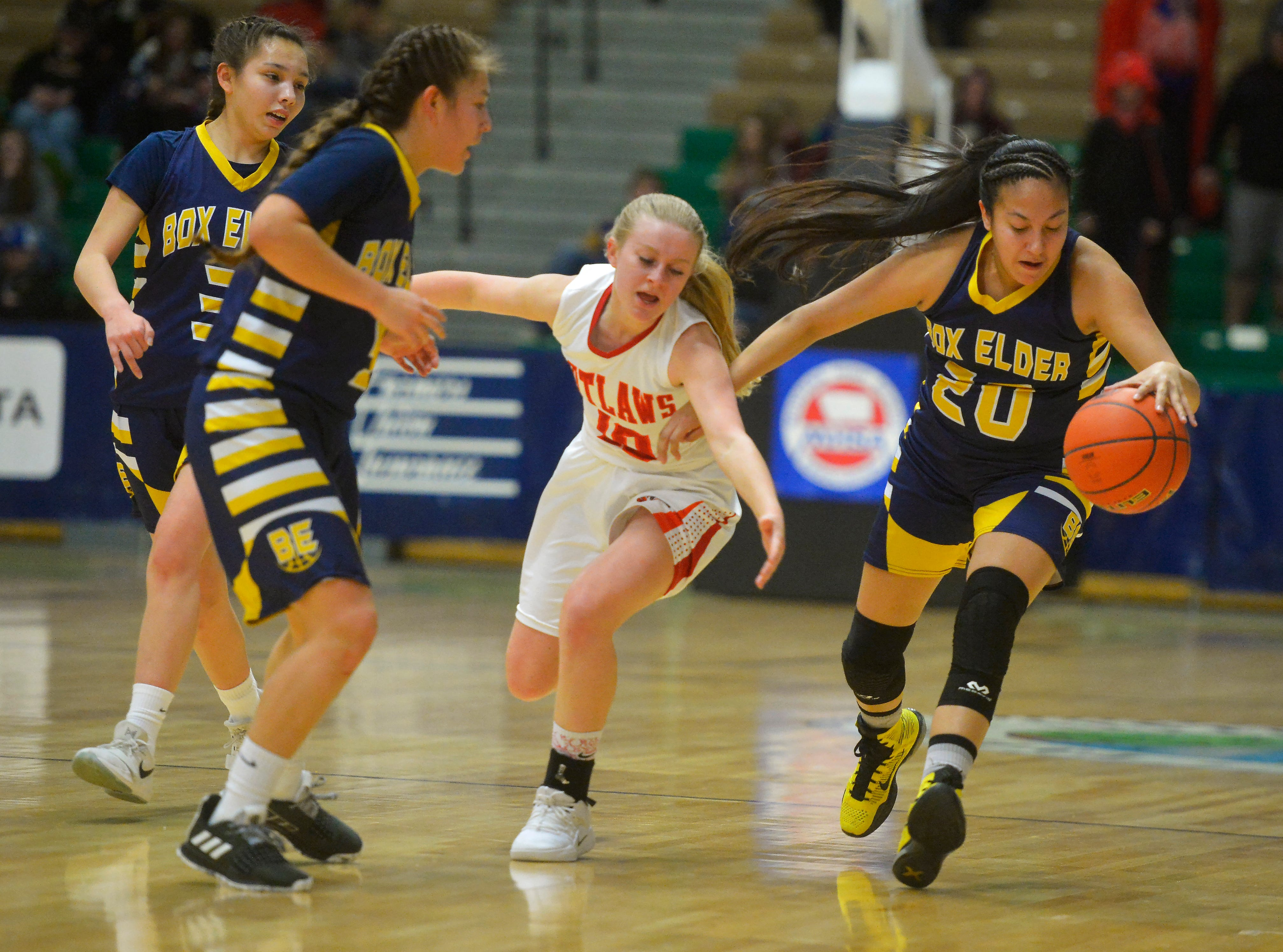 Box Elder and Roy Winifred play in the Class C state basketball championship game in the Four Seasons Arena, Saturday.