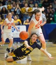 Box Elder's Joelnell Momberg and Roy-Winifred's Dyauni Boyce chase after a loose ball during the Class C state basketball championship game on Saturday in the Four Seasons Arena.