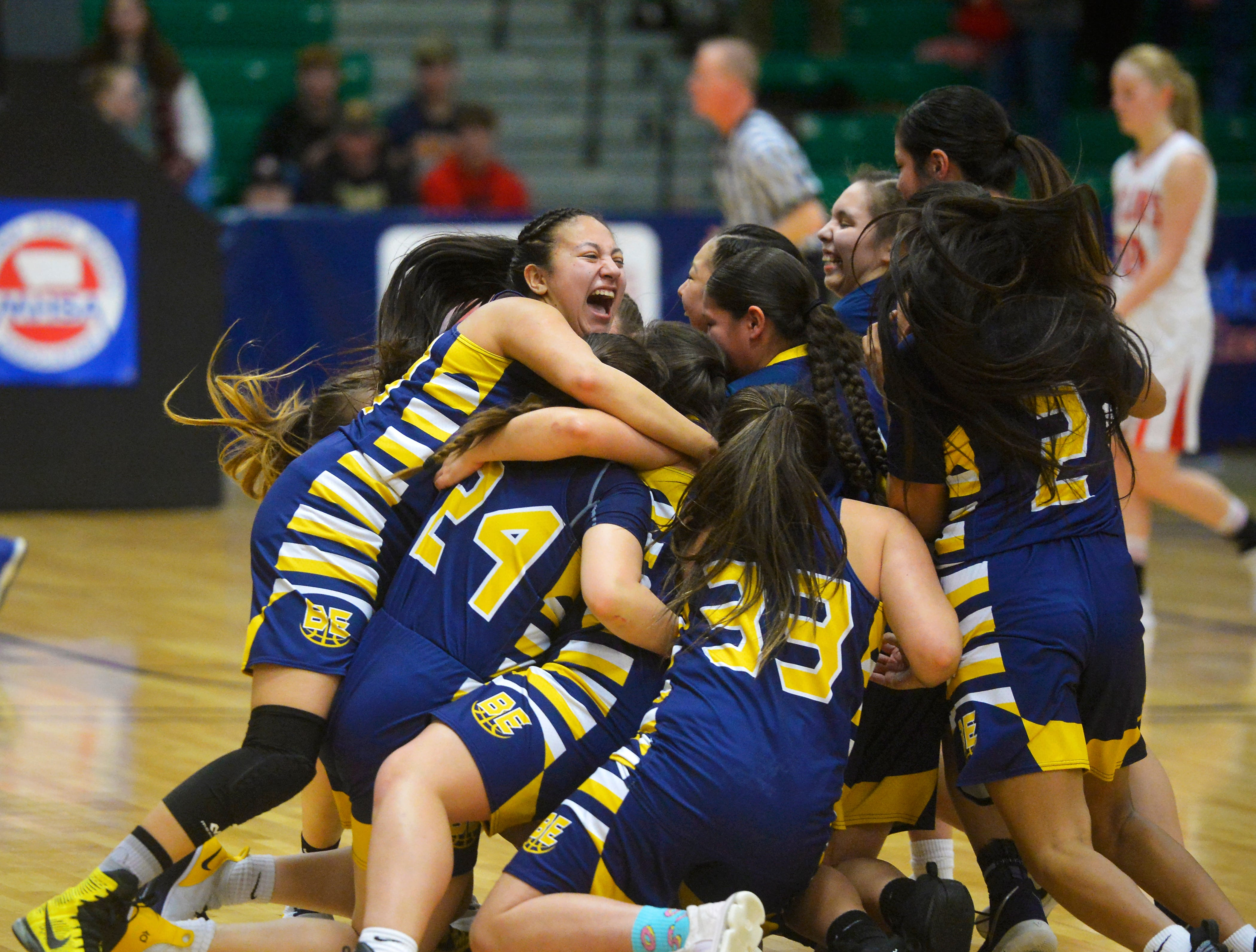 The Box Elder girls celebrate at center court after their 48-42 victory over Roy-Winifred in the Class C state basketball championship game on Saturday night in the Four Seasons Arena.