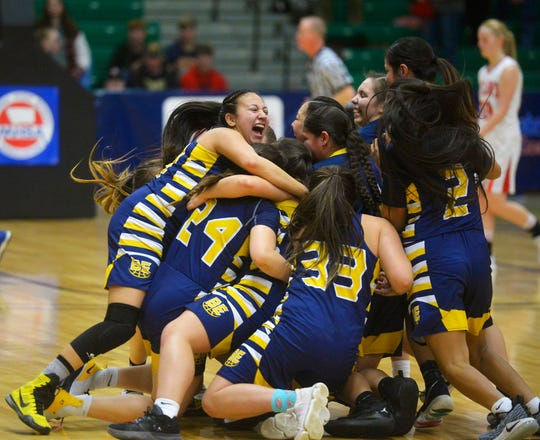 The Box Elder girls celebrate at center court after their 48-42 victory over Roy-Winifred in the Class C state basketball championship game on Saturday night in the Four Seasons Arena. Seven more state championship teams will be crowned this weekend.