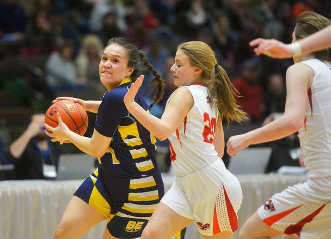Joelnell Momberg drives to the basketball during the State C girls' basketball tournament last March.