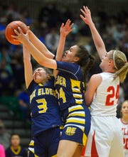 Box Elder's Joelnell Momberg grabs a rebound while between her teammate Sarah Parisian and Roy-Winifred's Madeline Heggem during the Class C state basketball championship game on Saturday in the Four Seasons Arena.