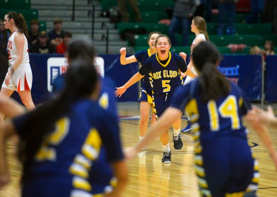 The Box Elder girls celebrate their 48-42 victory over Roy-Winifred in the Class C state basketball championship game on Saturday night in the Four Seasons Arena.