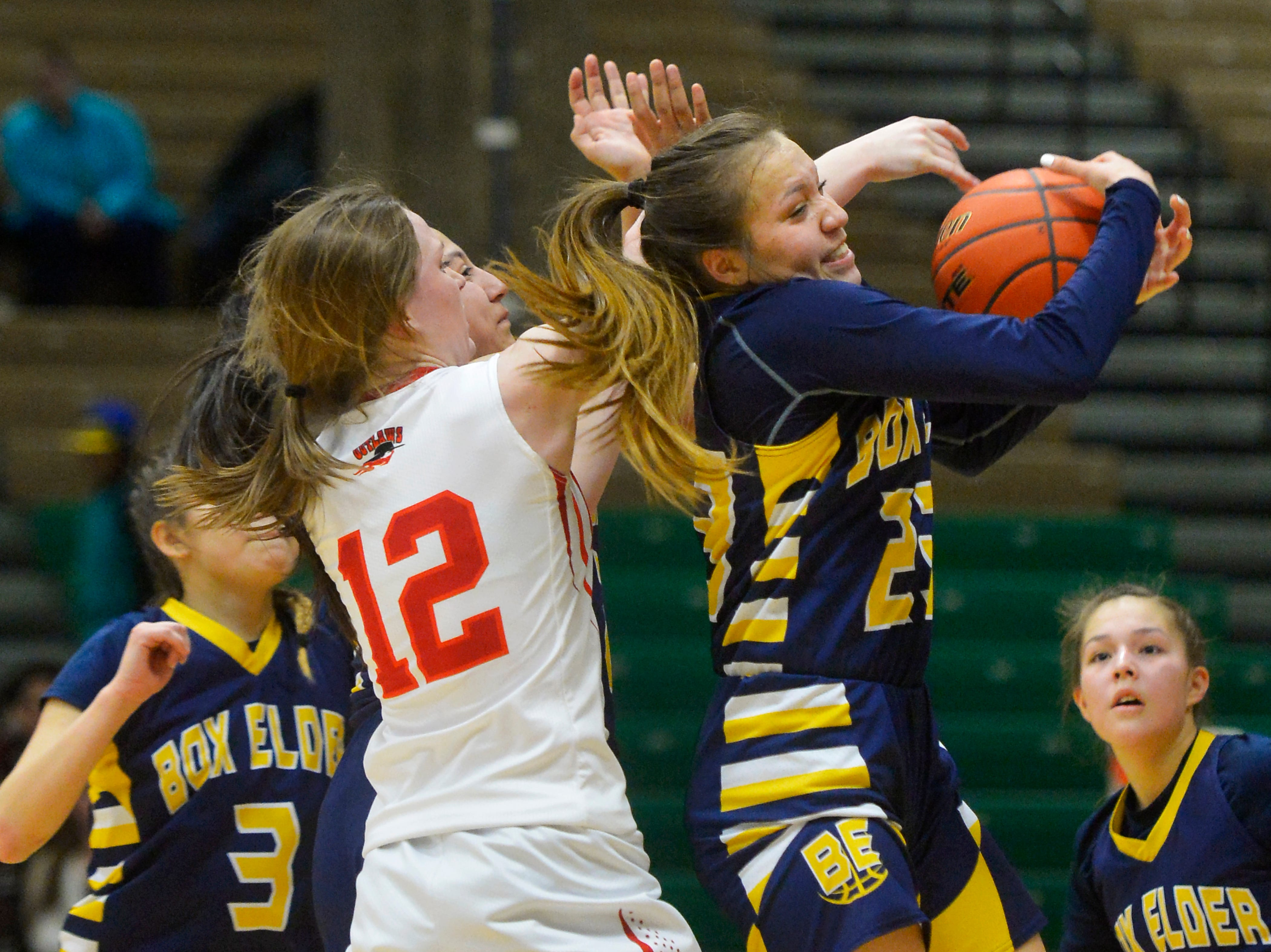 Box Elder's Kayla Momberg grabs a rebound in Saturday's Class C basketball state championship game against Roy-Winifred in the Four Seasons Arena.