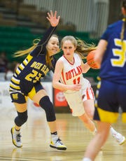 Roy-Winifred's Olivia Greer attempts to dribble passed Box Elder's Joelnell Momberg during the championship game of the Class C Girls State Basketball Tournament on Saturday in Four Seasons Arena.