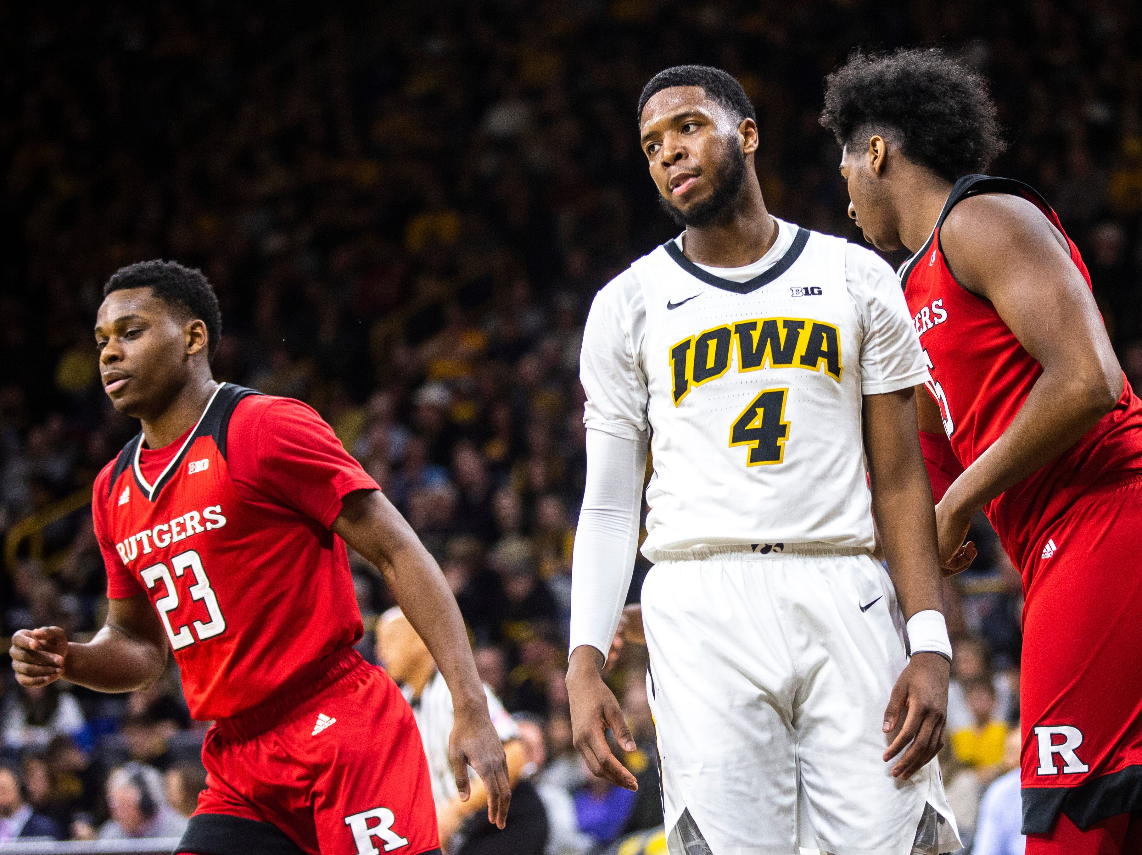 Iowa guard Isaiah Moss (4) reacts after Rutgers guard Montez Mathis (23) made a shot during a NCAA Big Ten Conference men's basketball game on Saturday, March 2, 2019, at Carver-Hawkeye Arena in Iowa City, Iowa.