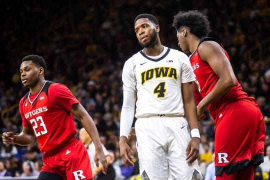 Iowa guard Isaiah Moss looks dejected after a made shot by Rutgers guard Montez Mathis (23) on Saturday at Carver-Hawkeye Arena. Moss was held scoreless for the third time this season. The Scarlet Knights got hot from the field and handed the Hawkeyes a damaging 86-72 loss.