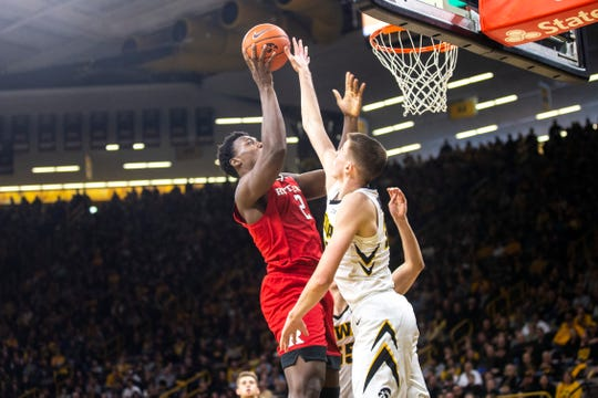 Rutgers center Shaquille Doorson makes a shot over Iowa forward Joe Wieskamp on Saturday at Carver-Hawkeye Arena. The Scarlet Knights outscored the Hawkeyes 36-18 in the paint in a dominating 86-72 victory.