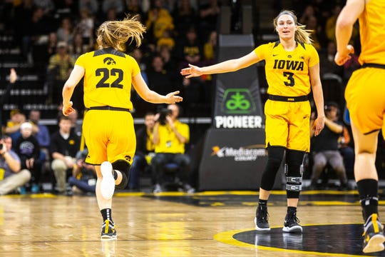 Iowa guard Kathleen Doyle (22) gets a high-five from Iowa guard Makenzie Meyer (3) during a NCAA Big Ten Conference women's basketball game on Sunday, March 3, 2019, at Carver-Hawkeye Arena in Iowa City, Iowa.