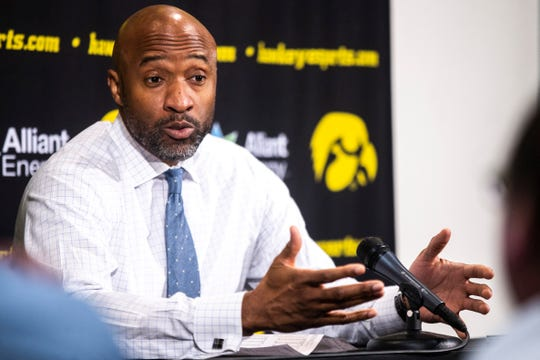 Iowa assistant Andrew Francis speaks to reporters after a NCAA Big Ten Conference men's basketball game on Saturday, March 2, 2019, at Carver-Hawkeye Arena in Iowa City, Iowa.