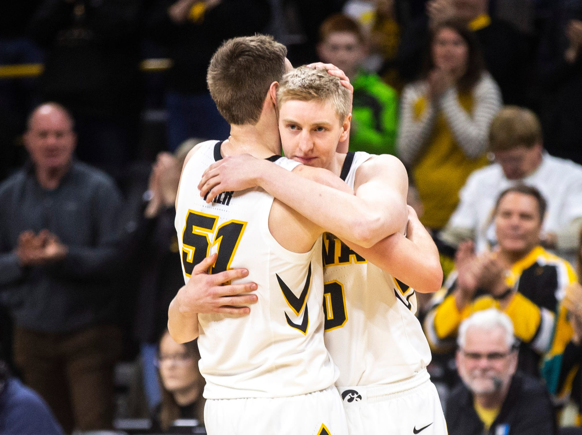 Iowa forward Nicholas Baer (51) embraces his brother, Iowa forward Michael Baer (0) during a NCAA Big Ten Conference men's basketball game on Saturday, March 2, 2019, at Carver-Hawkeye Arena in Iowa City, Iowa.
