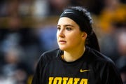 Iowa center Megan Gustafson (10) warms up before a NCAA Big Ten Conference women's basketball game on Sunday, March 3, 2019, at Carver-Hawkeye Arena in Iowa City, Iowa.