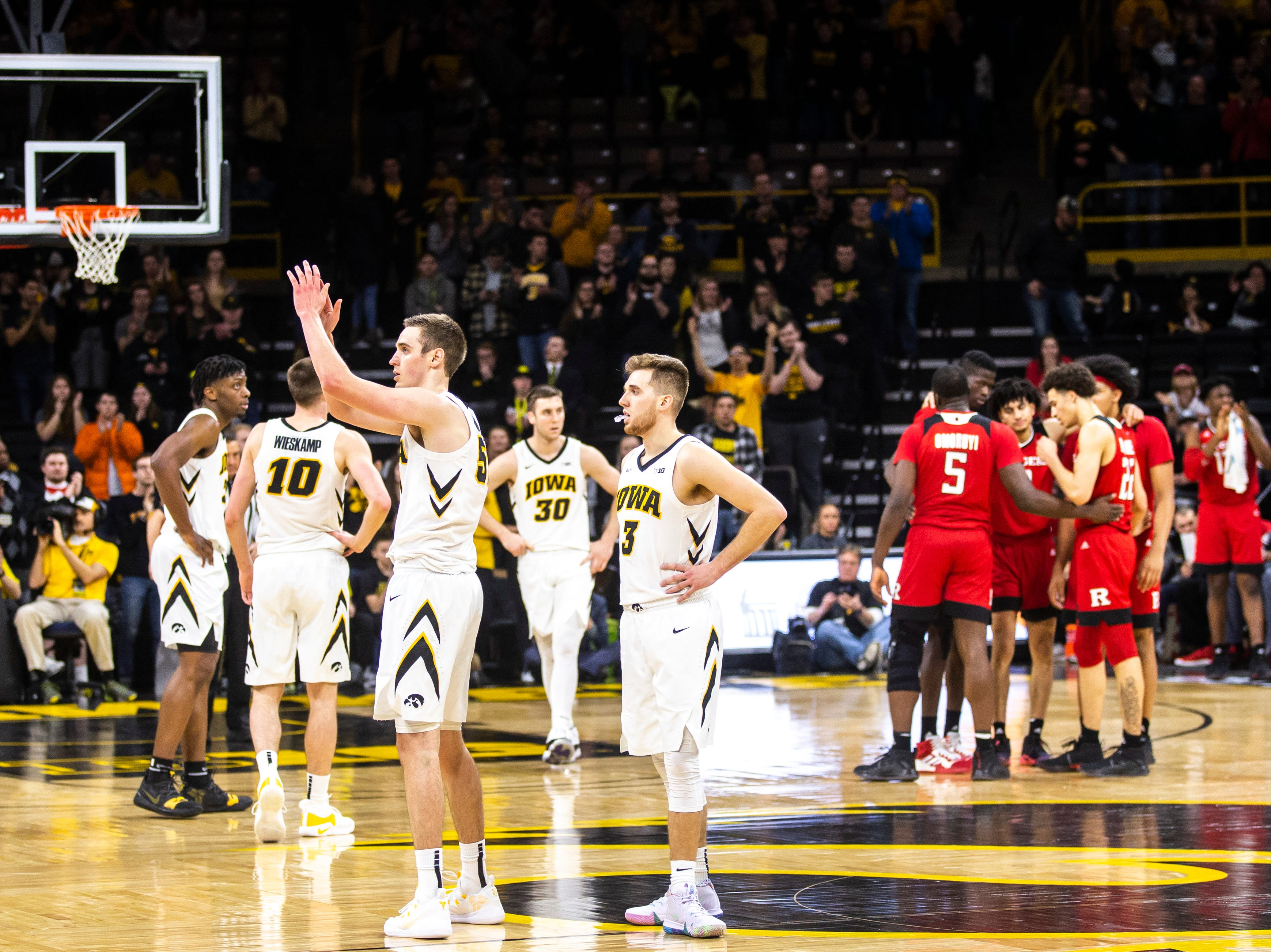 Iowa forward Nicholas Baer (51) thanks the crowd during a NCAA Big Ten Conference men's basketball game on Saturday, March 2, 2019, at Carver-Hawkeye Arena in Iowa City, Iowa.