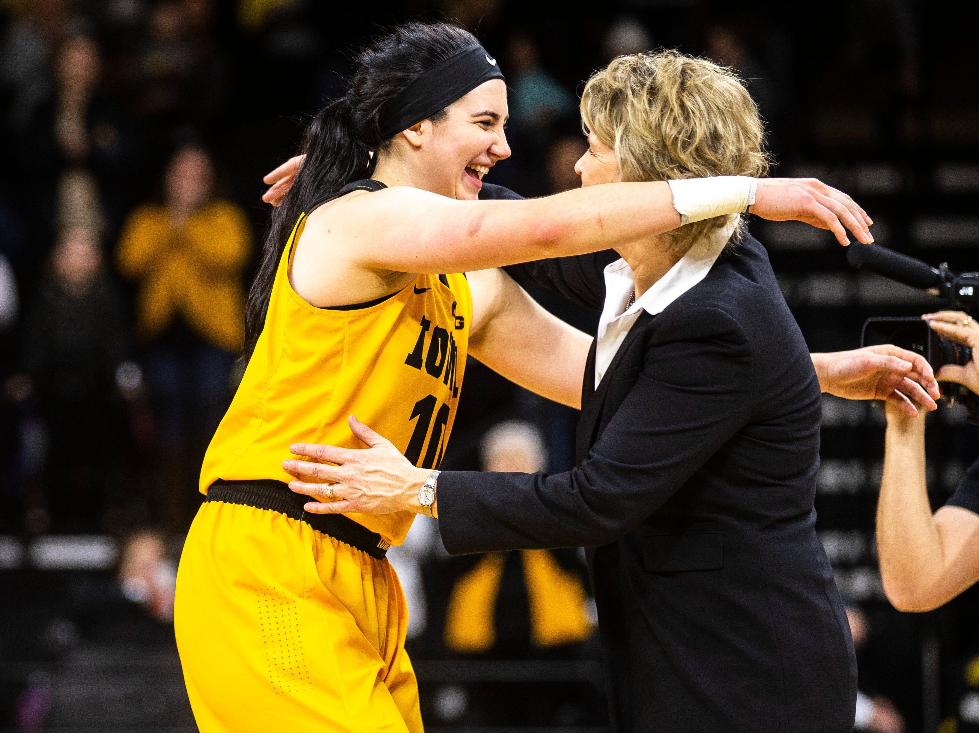 Iowa center Megan Gustafson (10) embraces Iowa head coach Lisa Bluder after a NCAA Big Ten Conference women's basketball game on Sunday, March 3, 2019, at Carver-Hawkeye Arena in Iowa City, Iowa.