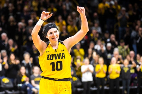 Iowa center Megan Gustafson (10) waves to fans while heading to the bench on senior day during a NCAA Big Ten Conference women's basketball game on Sunday, March 3, 2019, at Carver-Hawkeye Arena in Iowa City, Iowa.
