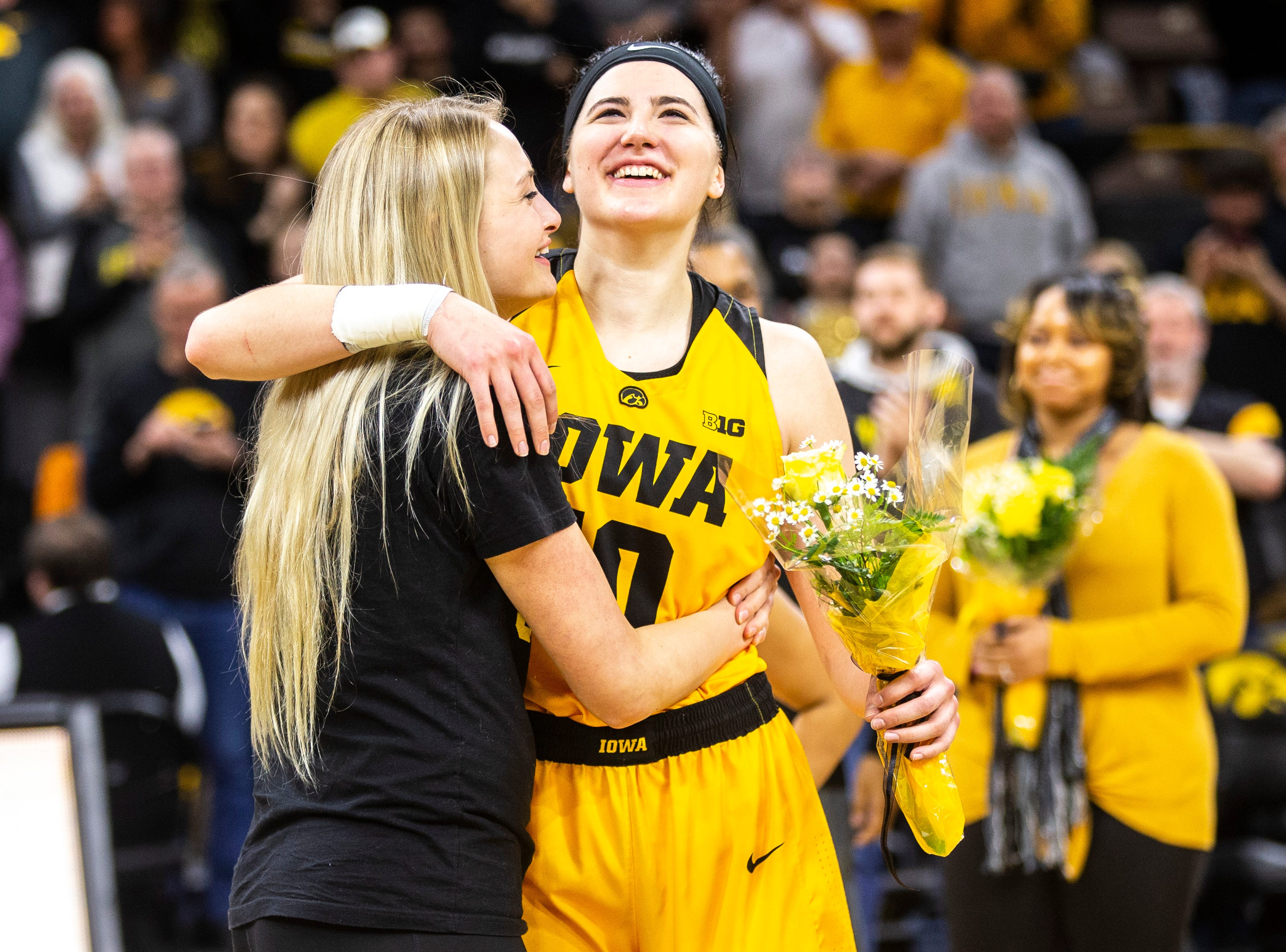 Iowa center Megan Gustafson (10) hugs her sister Emily after a NCAA Big Ten Conference women's basketball game on Sunday, March 3, 2019, at Carver-Hawkeye Arena in Iowa City, Iowa.