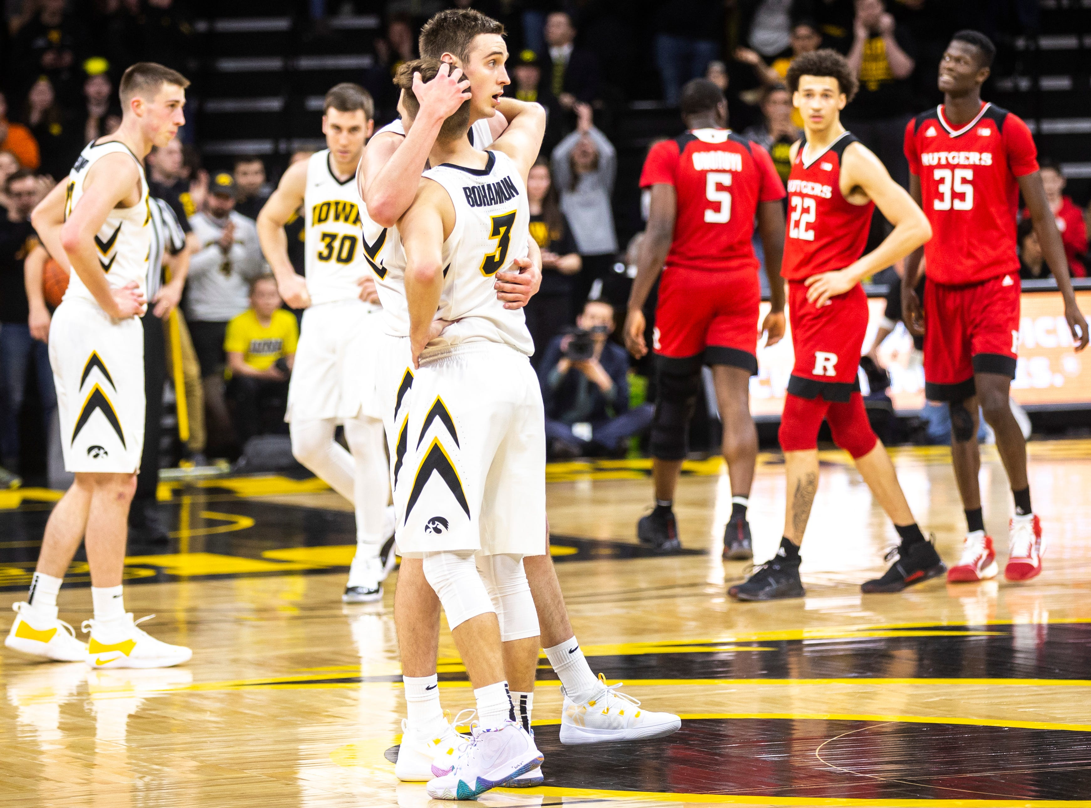 Iowa guard Jordan Bohannon (3) gives Iowa forward Nicholas Baer (51) a hug during a NCAA Big Ten Conference men's basketball game on Saturday, March 2, 2019, at Carver-Hawkeye Arena in Iowa City, Iowa.