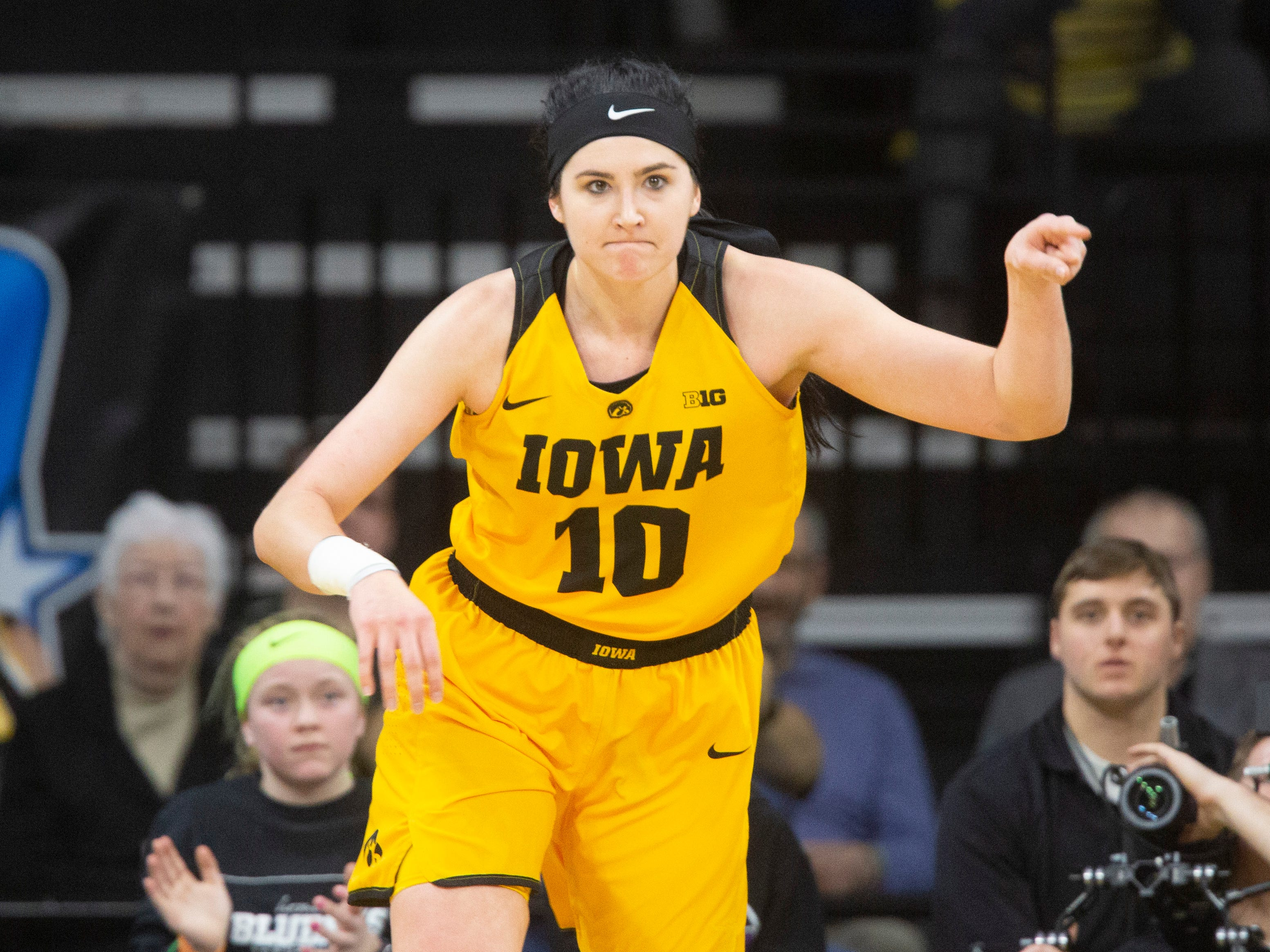Iowa center Megan Gustafson (10) reacts after making a basket during a NCAA Big Ten Conference women's basketball game on Sunday, March 3, 2019, at Carver-Hawkeye Arena in Iowa City, Iowa.