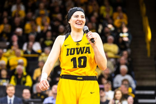 Megan Gustafson addresses the Iowa fans after a 74-50 win against Northwestern at Carver-Hawkeye Arena. She scored 34 points with 12 rebounds.