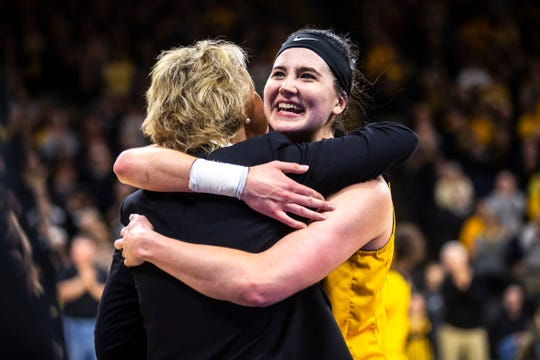 Iowa center Megan Gustafson, right, hugs Iowa head coach Lisa Bluder during a NCAA Big Ten Conference women's basketball game on Sunday, March 3, 2019, at Carver-Hawkeye Arena in Iowa City, Iowa.