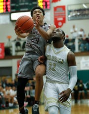 Lawrence Central Bears Nijel Pack (24) drives on and is fouled by Warren Central Warriors David Bell (22) in the second half of their game at Lawrence North High School on Saturday, Mar 2, 2019. The Lawrence Central Bears defeated the Warren Central Warriors  67-52.