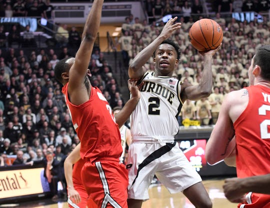 Mar 2, 2019; West Lafayette, IN, USA; Purdue Boilermakers guard Eric Hunter Jr. (2) drives or a shot past the Ohio State Buckeye defenders in the 2nd half at Mackey Arena.