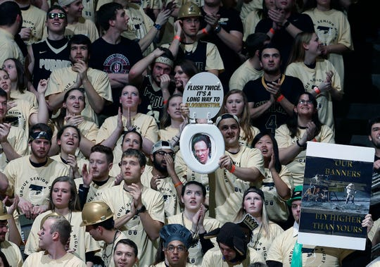 Purdue Boilermaker fans hold up signs during a game against the Indiana Hoosiers at Mackey Arena in 2017.