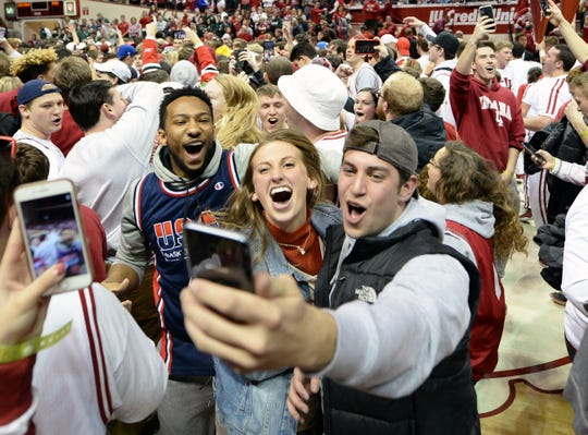 Fans storms the court after Indiana defeated Michigan State at Simon Skjodt Assembly Hall in Bloomington, Ind., on Saturday, March 2, 2019.