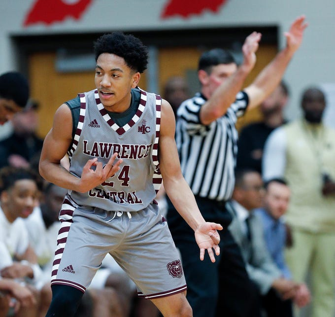 Lawrence Central Bears Nijel Pack (24) celebrates hitting a three-point shot in the first half of their game at Lawrence North High School on Saturday, Mar 2, 2019. The Lawrence Central Bears defeated the Warren Central Warriors  67-52.