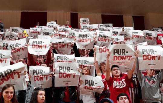 Indiana Hoosiers fans holds up signs during player introductions before the game against the Purdue Boilermakers at Assembly Hall in 2018.