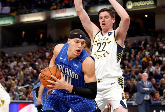 Mar 2, 2019; Indianapolis, IN, USA; Orlando Magic forward Aaron Gordon (00) is guarded by Indiana Pacers forward TJ Leaf (22) during the first quarter at Bankers Life Fieldhouse.