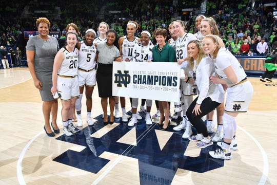 Mar 3, 2019; South Bend, IN, USA; The Notre Dame Fighting Irish pose for photos after defeating the Virginia Cavaliers at the Purcell Pavilion.