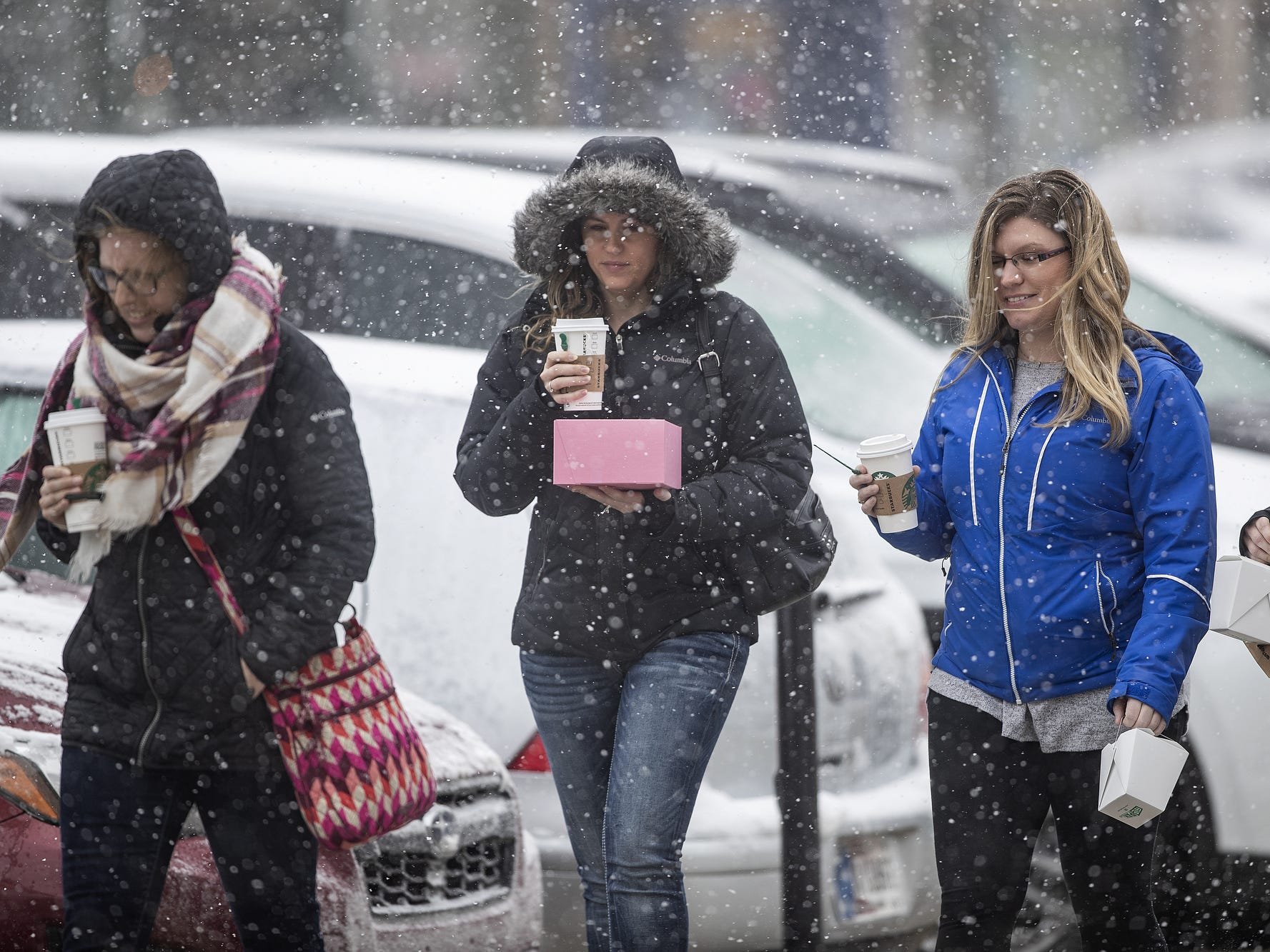 From left, Tory David, Alicia Anderson, Megan Briley and Lauren Foley enjoyed candle-making, dining and shopping on Mass Ave. during Sunday afternoon's snowfall in Indianapolis on March 3, 2019.
