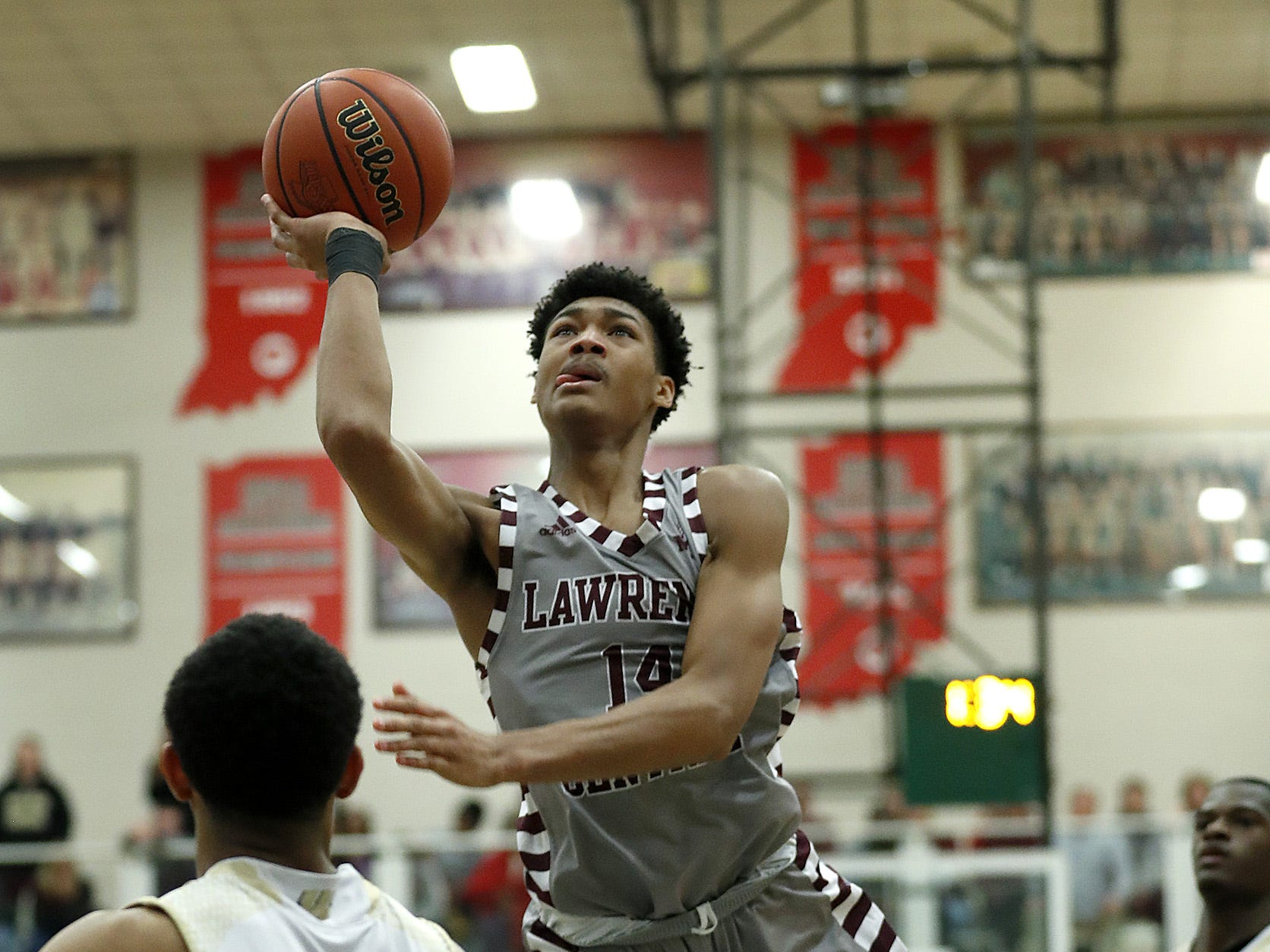 Lawrence Central Bears Dre Davis (14) is fouled by Warren Central Warriors David Bell (22) in the second half of their game at Lawrence North High School on Saturday, Mar 2, 2019. The Lawrence Central Bears defeated the Warren Central Warriors  67-52.