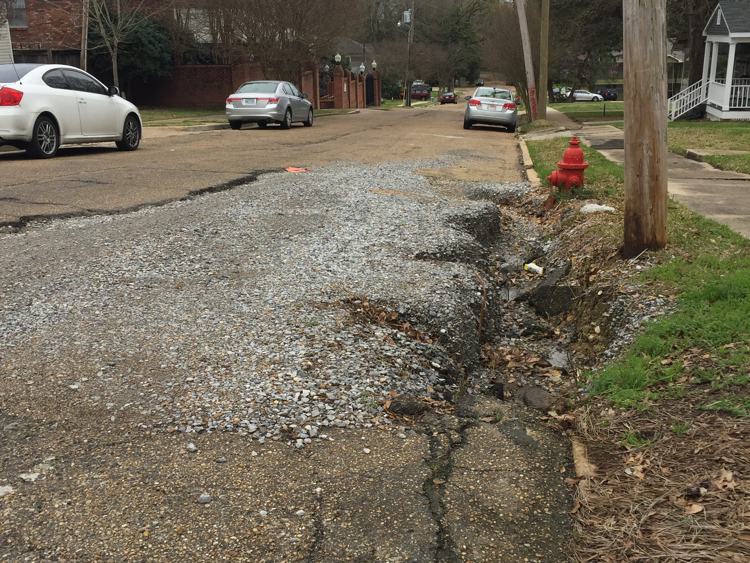 Drivers on the 900 block of Harding St. in Jackson's Belhaven neighborhood must deal with this street daily, pictured here on Saturday, March 2, 2019, including those living in an apartment complex.