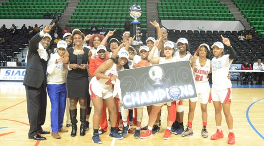 Lane College's players and coaches on the women's basketball team celebrate the program's first-ever conference championship after winning the SIAC on Saturday.