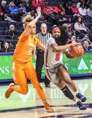 Mississippi's Crystal Allen (5) drives the lane against Tennessee's Rae Burrell (12) on Sunday.